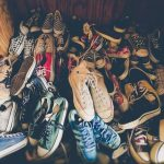Pile of old shoes in a closet