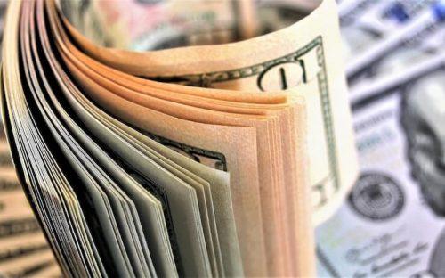 Stack of 10 dollar bills and hundred dollar bills