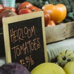 Heirloom tomatoes for sale on a counter