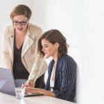 two business women working on becoming a real estate agents together