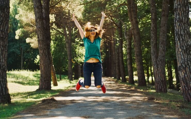 woman happy she got hired jumping for joy