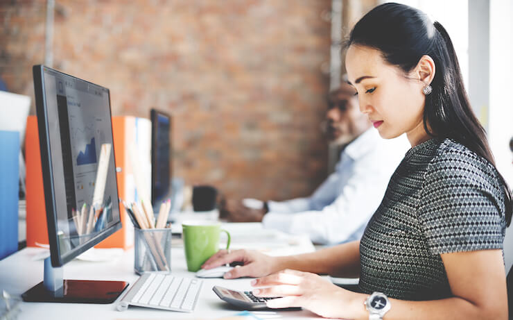 Woman looking into credit karma tax on her computer
