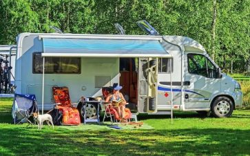 Woman reading a book outside while RV camping