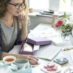 woman selling things online looking into drop shipping