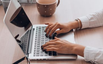 woman working from home doing data entry