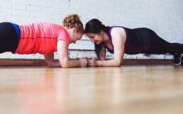 Women planking and working out to get healthy together